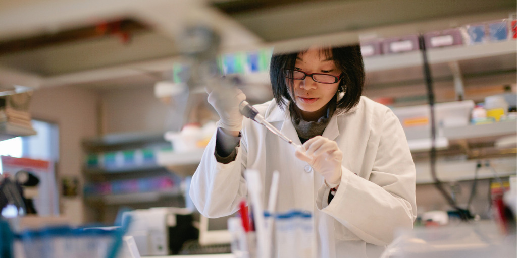 scientist-pipetting-at-a-biomedical-laboratory-picture-id821092062